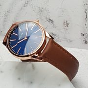 Rose Gold Watch on stand